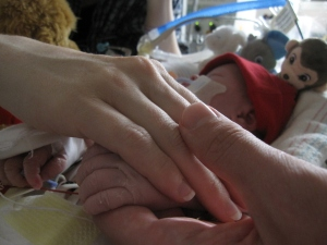Michaud family holding hands